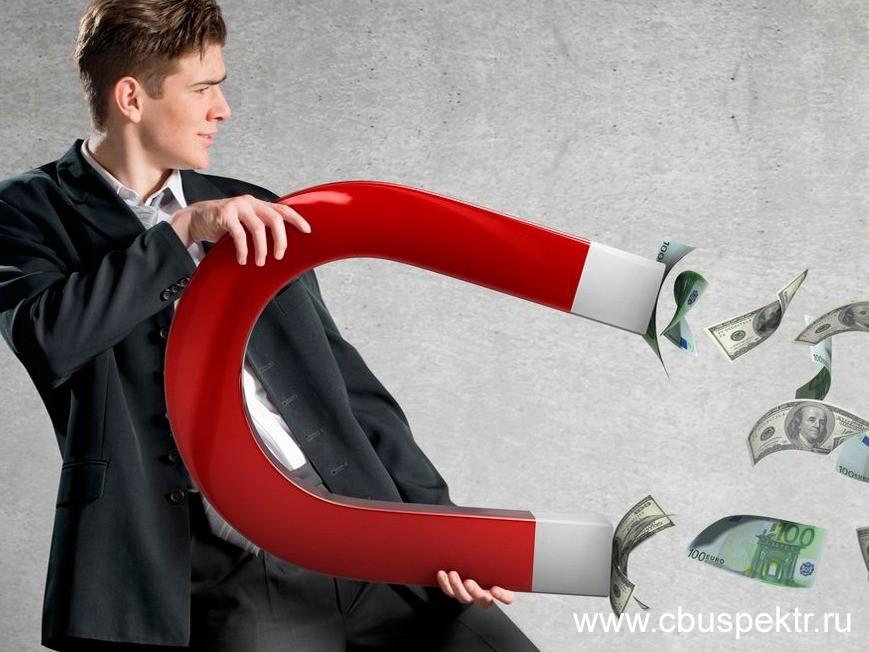 Бизнесмен притягивает магнитом деньги